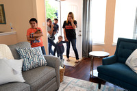 Houston Rockets head coach Mike DÕAntoni, his wife Laurel DÕAntoni, Rooms To Go, and Marie Flanigan Interiors partnered to redecorate the home of local family which lost most of their possessions due